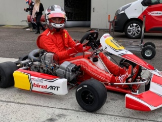 Leclerc also in red with karts.