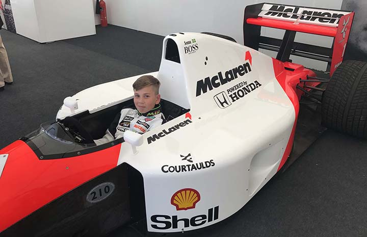 A young kart driver in the land of (big) toys